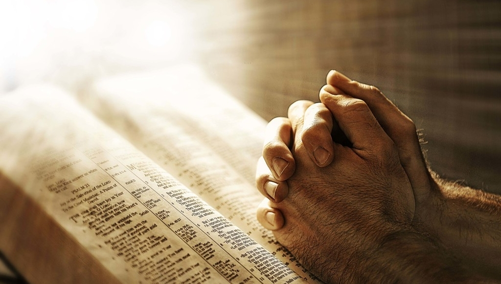 bible-hands-in-prayer